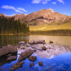 Reflections in the Lake: the Mountains, the Forest, the Blue Sky